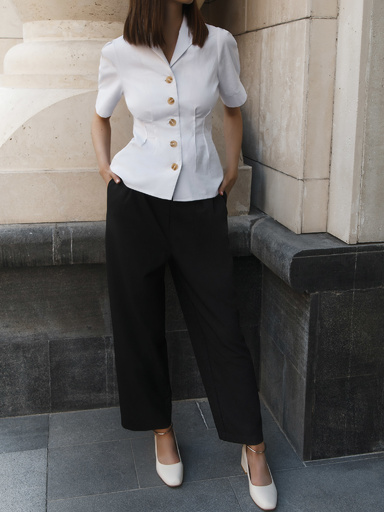 The fitted button-down blouse