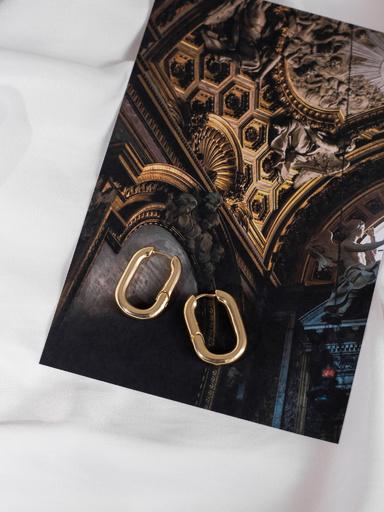Серьги из металла овальной формы