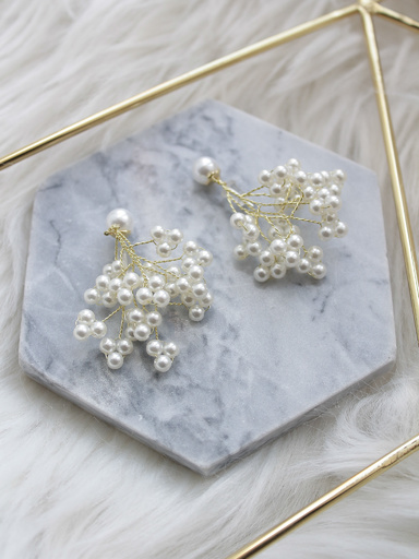 Drop earrings with branched pendant and pearl beads